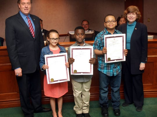 Union County Freeholder Chairman Bruce H. Bergen and Freeholder Bette Jane Kowalski present resolutions to the 4th grade winners of 2016 Union County Arbor Day Poetry Contest. (From 2nd left) Miriam Walsh from the Holy Trinity School in Westfield won first place. Devon from the Franklin Elementary School in Union won second place. Asher Wallace from the Franklin Elementary School in Union won third place.