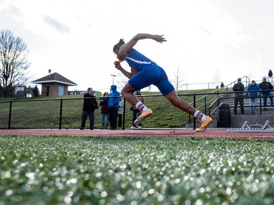 Spring Grove's Noah Hayes takes off during the 400-relay,