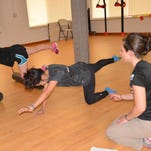Marianne Johns, MS, AT, athletic trainer and dance training specialist at MercyElite Sports Performance (right), instructs dancers through strength exercises unique to their ability and body mechanics.
