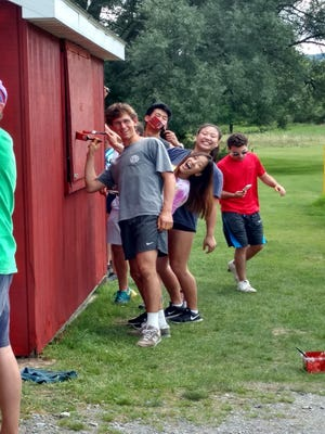 A team of Cornell POST (Pre-Orientation Service Team) students help update the dugouts at the Kenny Van Sickle memorial ball fields on Elm Street.