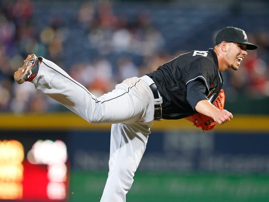 Miami Marlins starting pitcher Jose Fernandez (16) works in the sixth inning of a baseball game against Atlanta Braves Tuesday, April 22, 2014 in Atlanta.  (AP Photo/John Bazemore)