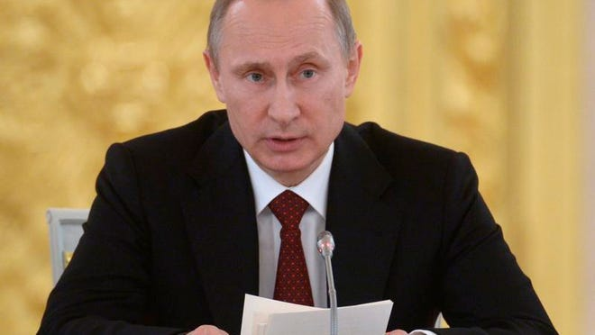 Russian President Vladimir Putin speaks during a Council of Physical Fitness and Sports in the Kremlin in Moscow, Russia, Monday, March 24, 2014. (AP Photo/RIA-Novosti, Alexei Nikolsky, Presidential Press Service)