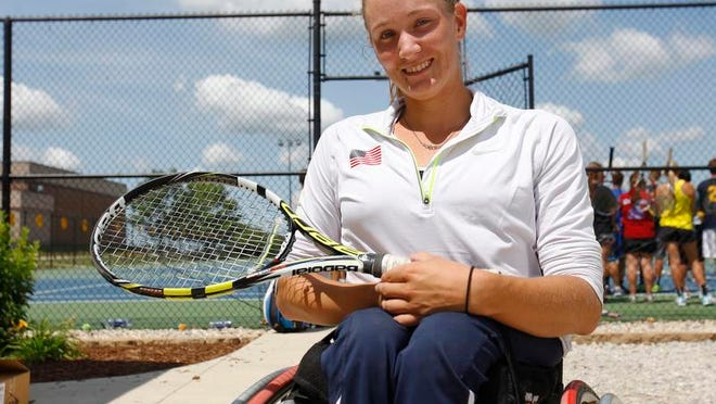 FILE -- Emmy Kaiser at a Tim Cleland Tennis Camp. Kaiser will be competing in her third Paralympics.