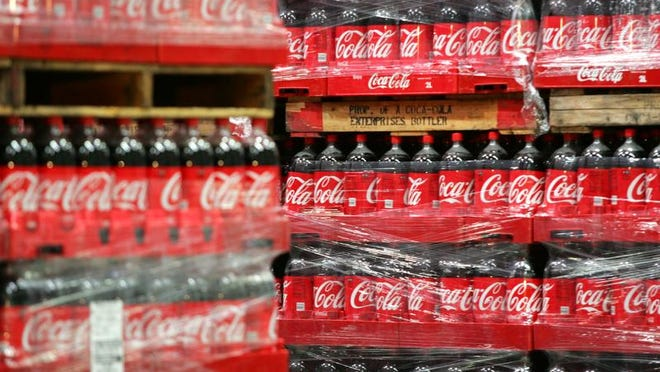 Pallets of bottled soda are stacked during the grand opening of the Coca-Cola Bottling Co. center in 2010 in Coachella.