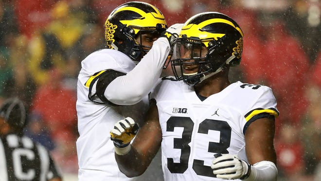 Taco Charlton, right, of the Michigan Wolverines celebrates after a sack against Rutgers Knights on Oct. 8, 2016, in Piscataway, New Jersey.