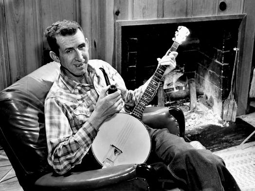 After breakfast March 20, 1962, Grand Ole Opry star Dave Akeman, known as Stringbean by his fans, sits in his leather reclining chair beside his fireplace for a few cups of coffee and to smoke his pipe before going fishing with his wife, Estelle.