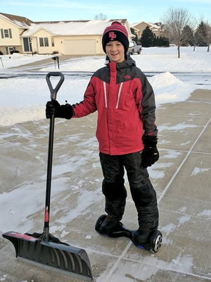 Tanner Scherer, 13, used his hoverboard to travel up and down his family's snow-filled Sun Prairie driveway with a shovel to take care of the recent snowfall. A video his dad shot of him doing this has gone viral.
