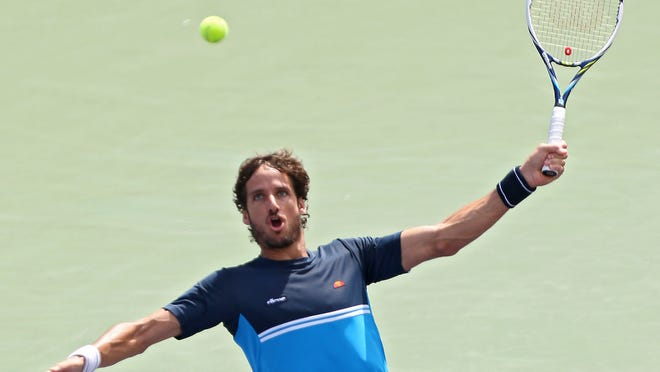 Feliciano Lopez hits a shot during his win over Kei Nishikori at the BNP Paribas Open, Wednesday, March 18, 2015.