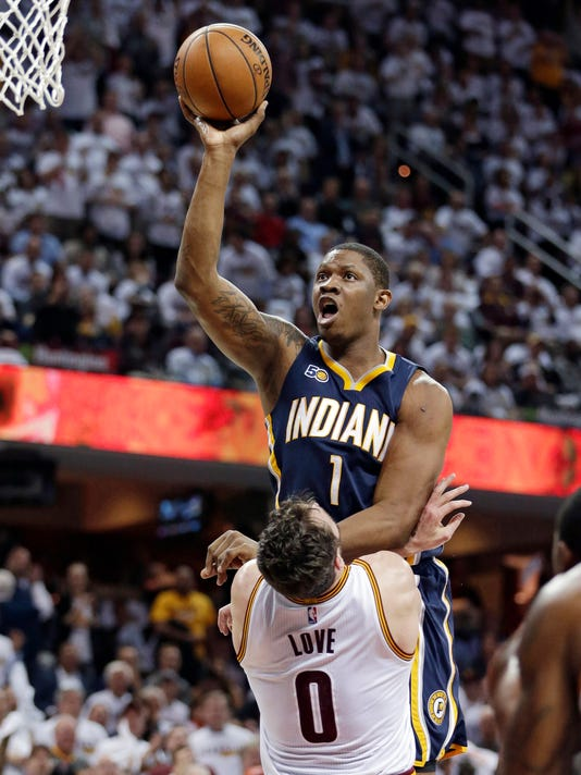 Indiana Pacers' Kevin Seraphin (1), from France, drives to the basket against Cleveland Cavaliers' Kevin Love (0) in the second half in Game 2 of a first-round NBA basketball playoff series, Monday, April 17, 2017, in Cleveland. Seraphin was called for an offensive foul. The Cavaliers won 117-111. (AP Photo/Tony Dejak)