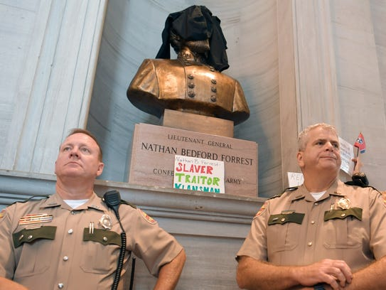 Troopers stand in front of a bust of Nathan Bedford