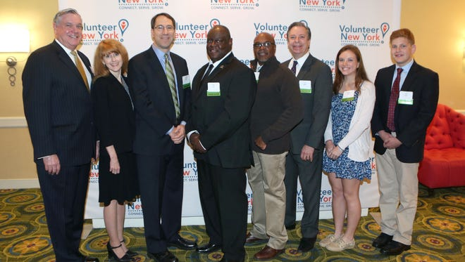 Honorees from left, Matthew G. McCrosson, Susan D. Croll, Robert Baron, Larry Fair, Leandro Francisco, Eric Nodiff, Sidney Woolf and Zach Lewis are pictured during the 36th annual Volunteer Spirit Awards at the Volunteer New York breakfast benefit at the Westchester Marriott Hotel in Tarrytown May, 4, 2016.