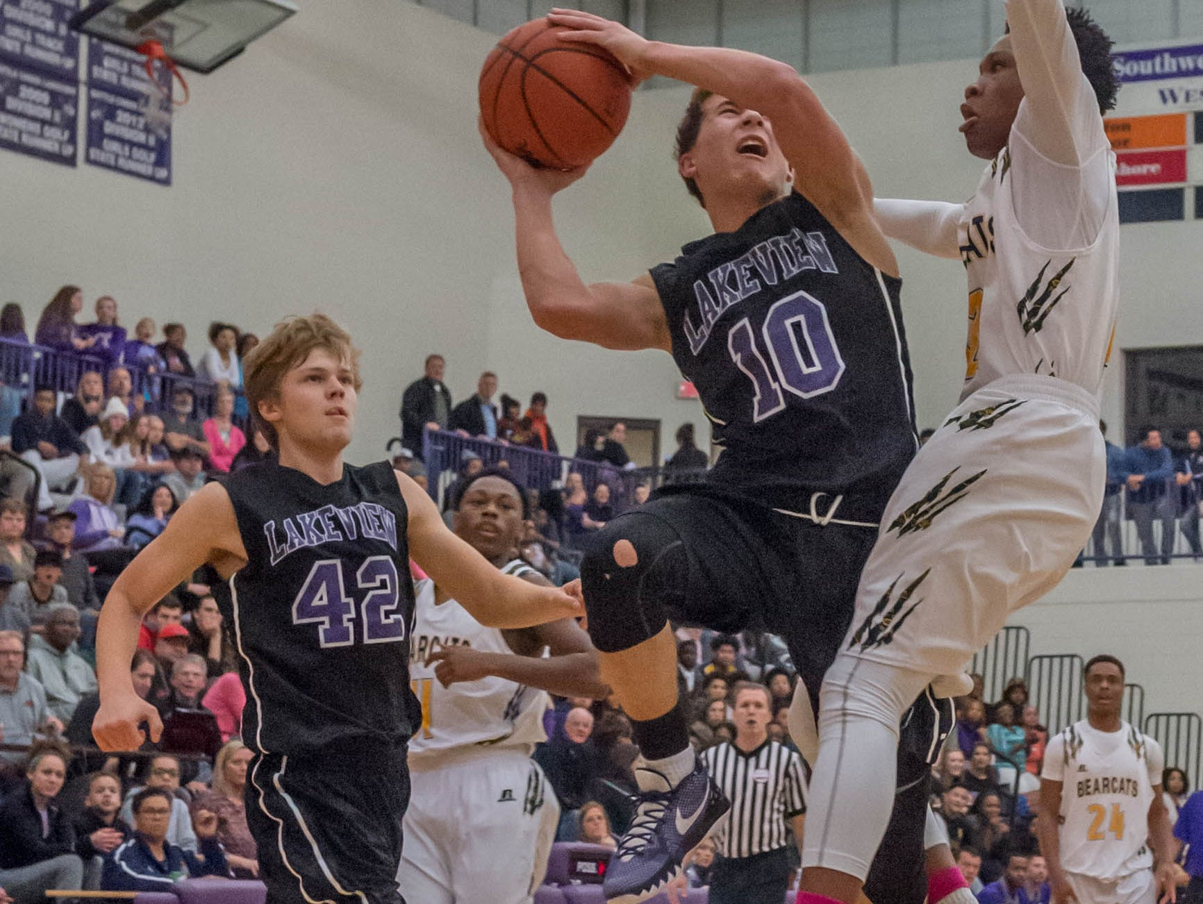 Lakeview's Gavin Homer (10) goes for the hoop against Battle Creek Central Friday evening.