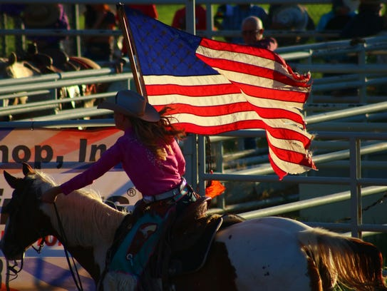 Loryn Danley, the 2016-2017 Fair and Rodeo Queen, displays
