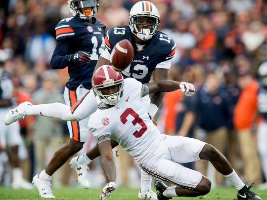 Auburn defensive back Javaris Davis (13) breaks up a pass intended for Alabama wide receiver Calvin Ridley (3) in first half action in the Iron Bowl in Auburn, Ala. on Saturday November 25, 2017.