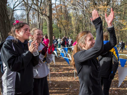 Padua cross country coach Marnie Giunta cheers as her runners gallop to the finish in the state meet.
