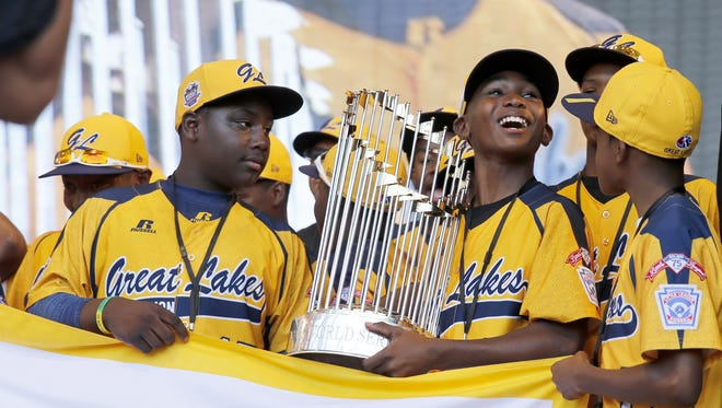 Members of the Jackie Robinson West All Stars Little League baseball team participate in a rally celebrating the team's U.S. Little League Championship Aug. 27, 2014, in Chicago.