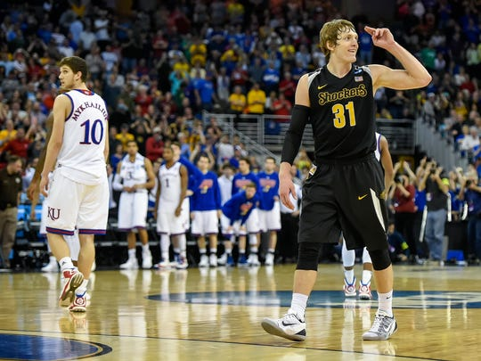 Wichita State Shockers guard Ron Baker (31) salutes the Wichita State fans at the final buzzer of their 78-65 victory over the Kansas Jayhawks during the third round of the NCAA men's basketball tournament on Sunday, March 22, 2015, at CenturyLink Center in Omaha, Neb.
