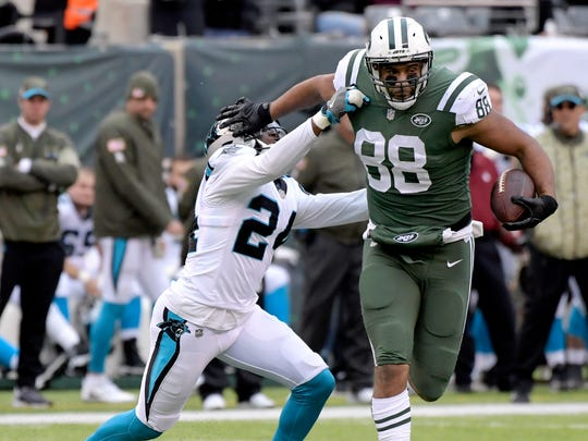New York Jets tight end Austin Seferian-Jenkins (88) applies a stiff arm on Carolina Panthers cornerback James Bradberry (24) during the first half of an NFL football game, Sunday, Nov. 26, 2017, in East Rutherford, N.J.