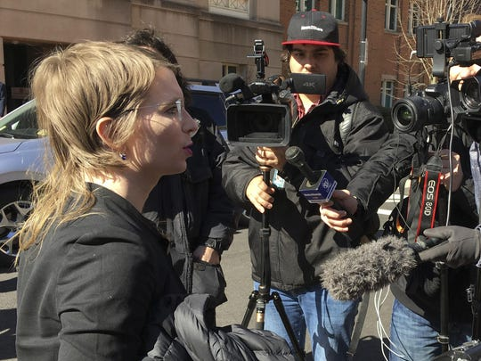 In this March 5, 2019, photo, Chelsea Manning addresses the media outside federal court in Alexandria, Va. The former Army intelligence analyst was ordered to jail March 8, 2019, for refusing to testify to a Virginia grand jury investigating Wikileaks.