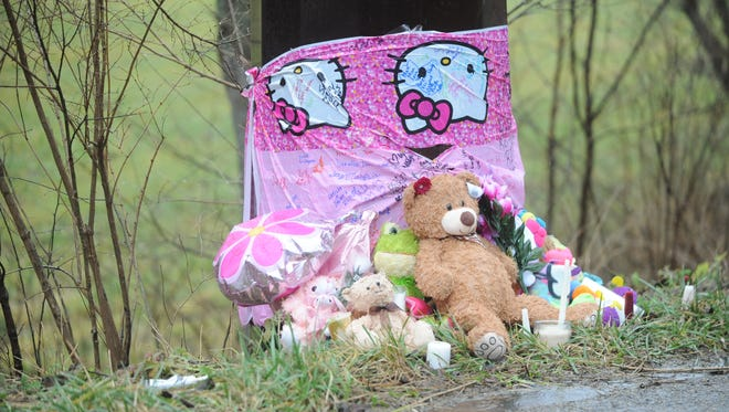 A memorial along Gravel Pit Road honors Nadra Craig, who died from injuries sustained in a Saturday accident at the location.