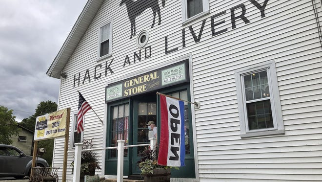 A man wearing a mask leaves a gift shop on Wednesday, July 15, in Hope Valley, Rhode Island. Could these be the good old days? Futurists and others say people may actually look back at 2020 with nostalgia if the coronavirus pandemic lingers and health and economic concerns worsen.