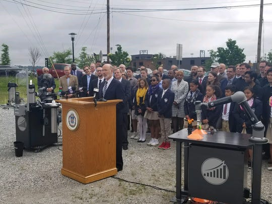 Gov. Tom wolf, surrounded by robots, students and members of York Exponential, announced a $6 million state grant to create a 240,000-square-foot technology-based innovation facility in Northwest Triangle.