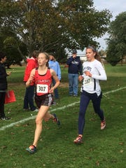 Bay Port junior Savannah Huben and Pulaski junior Annika Linzmeier race at the WIAA Division 1 Manitowoc sectional.