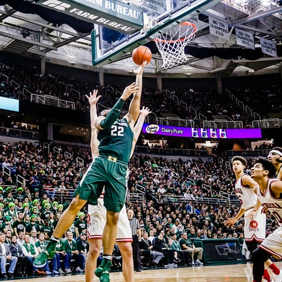 Miles Bridges ,22, of MSU lays the ball up and in during