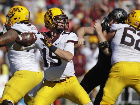 Minnesota quarterback Conor Rhoda (15) throws to a receiver in the second half Oct. 15 against Maryland in College Park, Md.