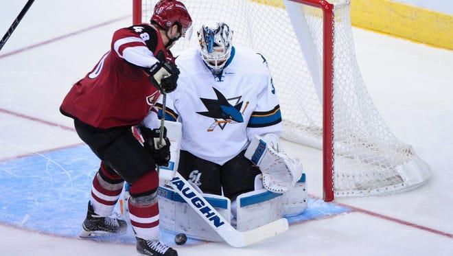 Oct. 2, 2015; Glendale; San Jose Sharks goalie Martin Jones (31) makes a save on Arizona Coyotes left wing Jordan Martinook (48) during the third period at Gila River Arena.