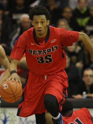 The Oakland Golden Grizzlies' Dante Williams goes after the Detroit Titans' Paris Bass during second half action on Sunday, February 15, 2015 at the Athletics Center O'rena in Rochester Hills.