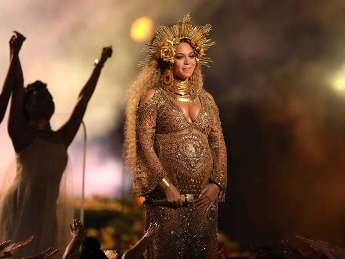 And let's not forget the iconic gold crowns that Beyonce