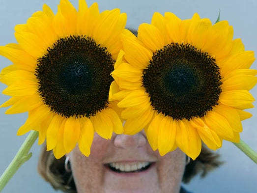 Mary Marston, owner of Plum Nelly flower farm  in Coushatta, Louisiana shows off some of her sunflowers.
