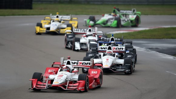 IndyCar driver Juan Pablo Montoya leads a group of cars through turn 12 during the Grand Prix of Louisiana at NOLA Motorsports Park.