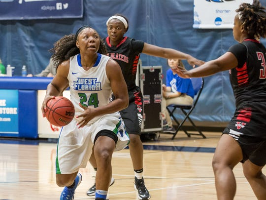 West Florida's Toni Brewer (24) prepares to go up for a shot during the first conference game of the season against Valdosta State Monday night at UWF.