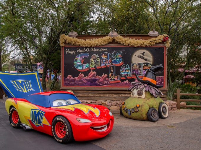 Lightning McQueen dresses as a superhero as Cars Land
