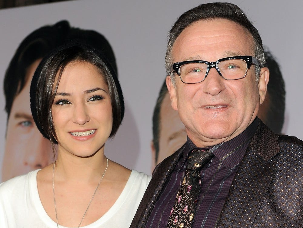 Zelda Williams, left, stands with her father Robin Williams at the premiere of