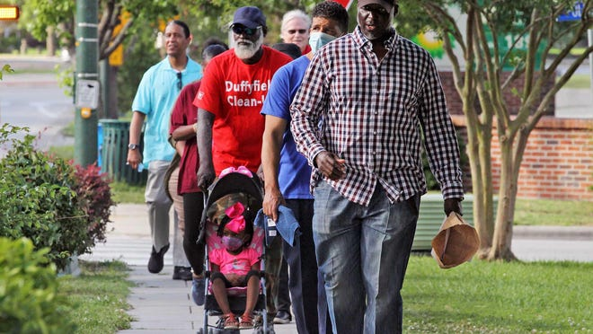 Local church members and clergy gather for a Faith Walk to Union Point Park in New Bern on June 5. The group walked together in support of faith and love in the light of recent protests and unrest occurring in the nation after the death of Minneapolis, Minn. resident George Floyd.