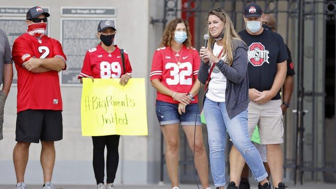 Amanda Babb, stepmother of Ohio State football player Kamryn Babb and president of Ohio State Football Parents Association, speaks to fans during a rally outside the rotunda of Ohio Stadium on August 29, 2020.