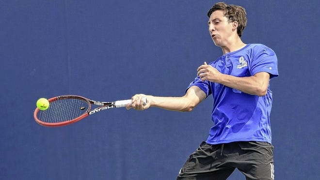 Senior Marcelo Aguilar of the Liberty boys tennis team returns a shot during a doubles match in the Division I state tournament last season. Aguilar will continue his career at Ohio Wesleyan.