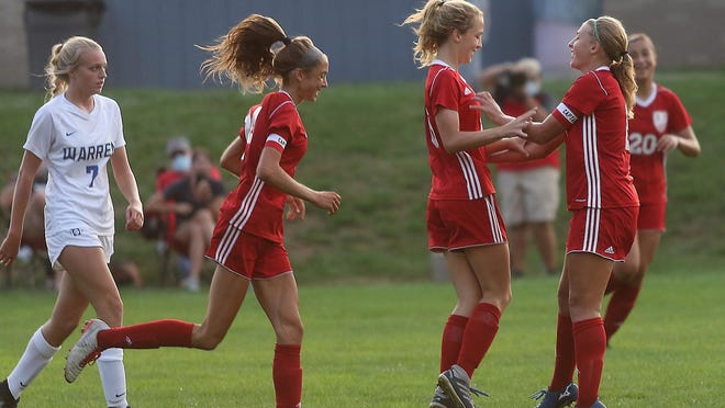 Dover celebrates a goal by Alyssa Feiler in the second half of the match with Warren Local Thursday.