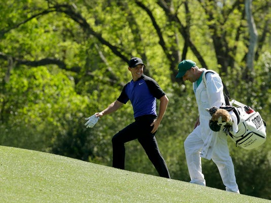 Rory McIlroy, of Northern Ireland, talks to his caddie while walking to the 12th hole during a practice round for the Masters golf tournament Tuesday, April 4, 2017, in Augusta, Ga. (AP Photo/Charlie Riedel)