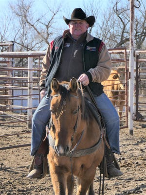 Bronc Rumford, a rodeo professional, rides on his ranch in Abbyville.