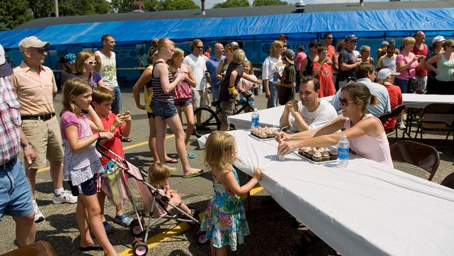 Participants take their seats at the Cold Spring Bakery Cupcake Eating Contest for the Hometown Pride Festival in 2010.