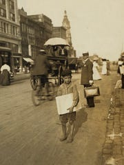 Barefoot Indianapolis newsboy in 1908.