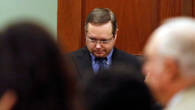 Eric Williams walks in the courtroom to hear his sentence during the punishment phase of his capital murder trial at the Rockwall County Courthouse on Wednesday, Dec. 17, 2014, in Rockwall, Texas.  The former justice of the peace was sentenced to death for killing a district attorney's wife in what prosecutors described as a revenge plot that left three people dead.