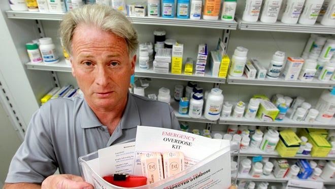 Pharmacist Sam Coletta, who owns Avenue Pharmacy in Dayton, Ky., shows an opioid overdose kit he designed in 2013.