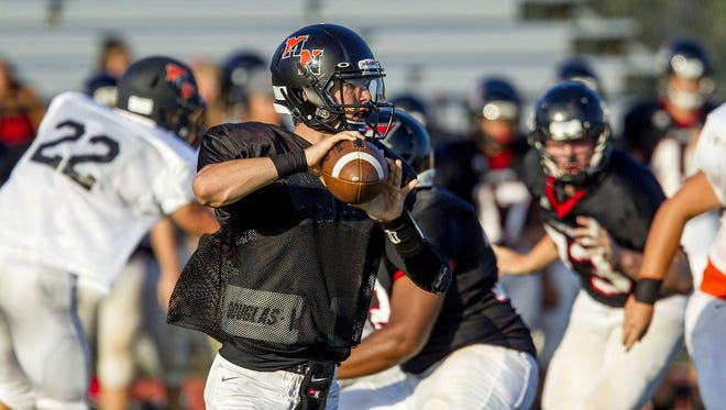 Middletown North quarterback Donald Glenn throws a pass during a scrimmage against Allentown.