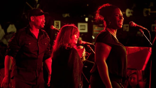 Michelle Moore (right) performs with the Alliance Singers at the Stone Pony in Asbury Park in 2014.