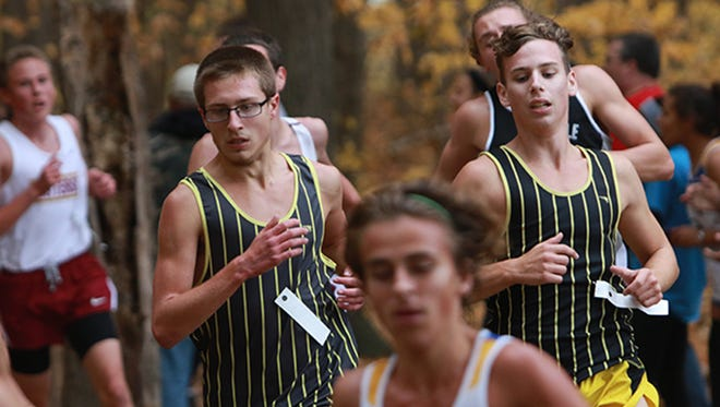Watkins Memorial's Jacob Gero and Gerick Brewer compete in the Division I district meet Oct. 24. The Warriors won the regional title this past Saturday.